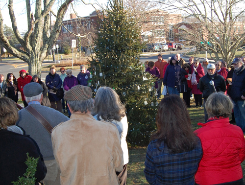 JO ANN KIRKLAND | Attendees encircle the  'Tree of Lights' at Saturday's ceremony.
