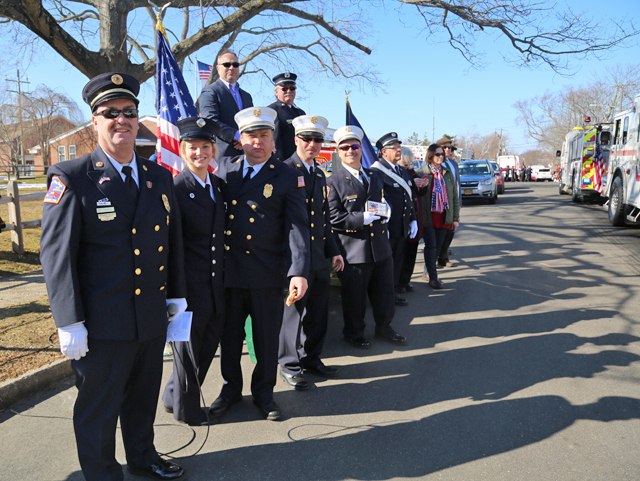Greenport Fire Department members and village trustees welcoming marchers at the end of the parade. (Credit: Krysten Massa)
