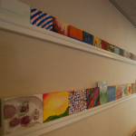 Artwork by residents and staff is displayed in common areas.