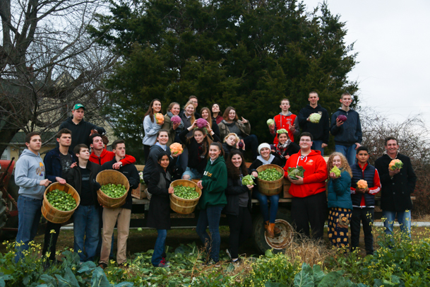The Southold high school students pose for a photo with the produce they collected.