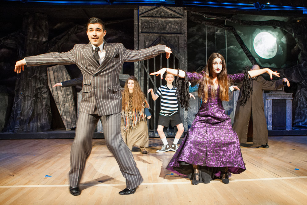 Gomez and Morticia Addams, played by William Tondo and Winter Wilcenski, lead their family members in a song and dance during a rehearsal for 'The Addams Family.' (Credit: Katharine Schroeder)