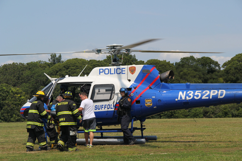 A child was airlifted Friday afternoon from the strawberry fields in Mattituck. (Credit: Joseph Pinciaro).