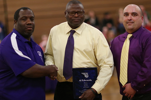 Al Edwards, center, was presented with a plaque during a pregame ceremony that included Greenport coach Ev Corwin, right, and assistant coach Rodney Shelby. (Credit: Garret Meade)