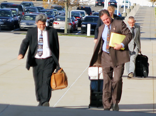 Former Mattituck teacher Anthony Claudio (right) entering the federal courthouse in Central Islip in October 2012 with his attorney, Frank Blangiardo. (Credit: Jennifer Gustavson, file)