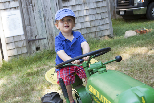 Levi Silverman, 17 months, of Southold rides a tractor kids' corner. (Credit: Katharine Schroeder photos)