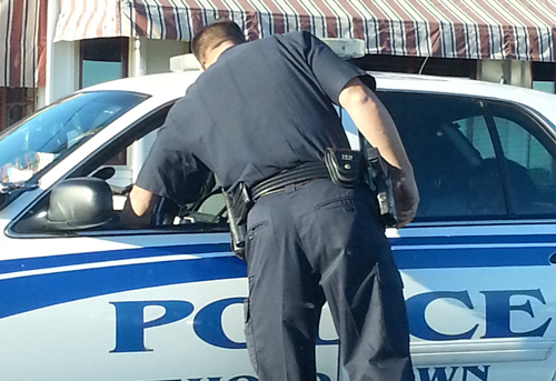 COURTESY PHOTO | Police respond to a call that a woman violated an order of protection in Greenport Sunday.