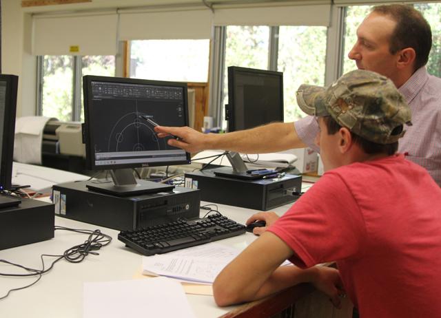 Mattituck teacher Steve Lavinio works with a student. (Credit: Jen Nuzzo)