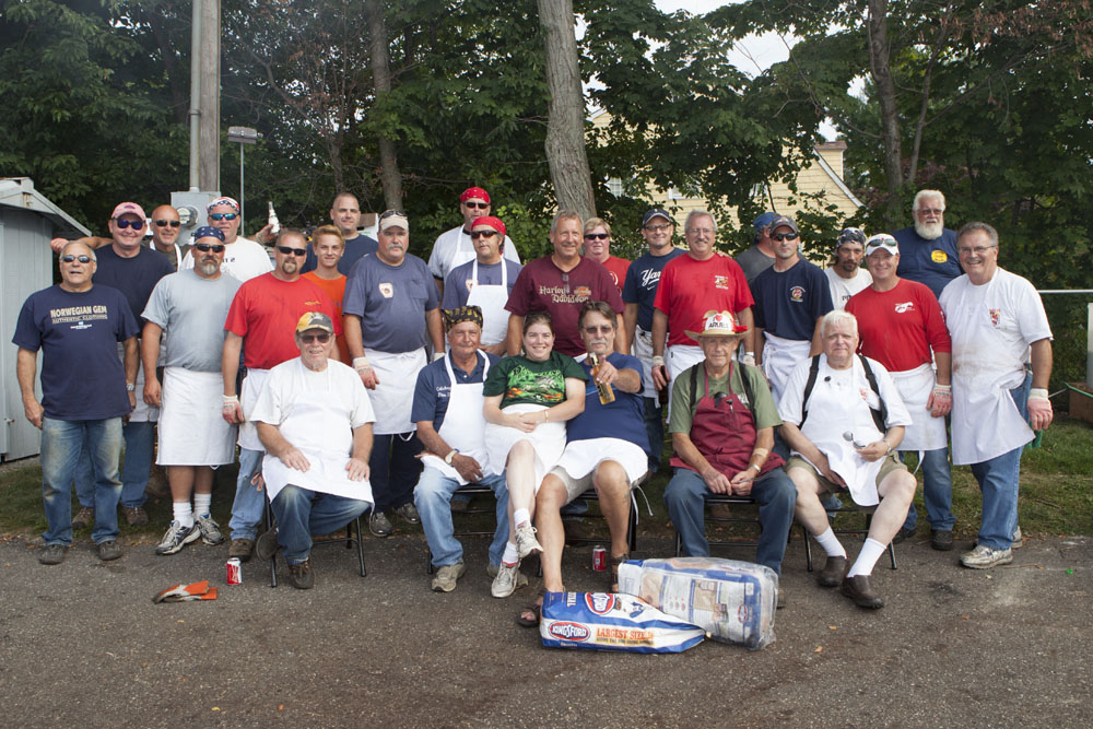 The men (and woman) who cook the chicken. (Credit: Katharine Schroeder)