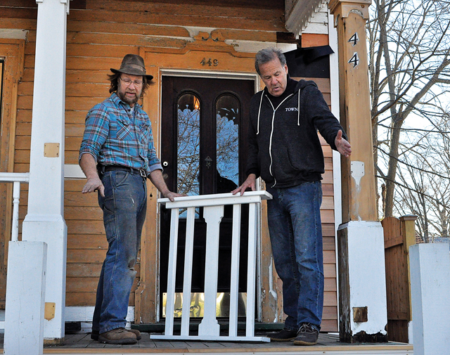 Builder Matthew Ritter (left) discusses placement of a new wooden railing with Bennett Brokaw, who is restoring this 19th-century house on Main Street in Greenport. (Credit: Rachel Young)