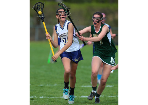 Bishop McGann-Mercy's Monica Healy defends against Mattituck/Greenport/Southold's Riley Hoeg, who prepares to take a shot. (Credit: Daniel De Mato)