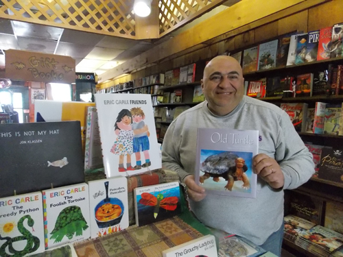 George Maaiki has owned Burton's Bookstore on Front Street in Greenport for the last 26 years. (Credit: Joseph Pinciaro)