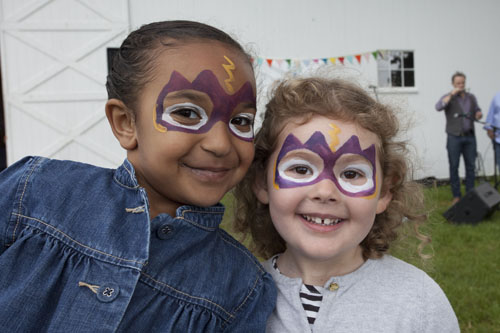 Rylee Owens, 5, of Greenport (left) and Emma Roner, 3, of Riverhead show off their painted faces. (Credit: Katharine Schroeder)