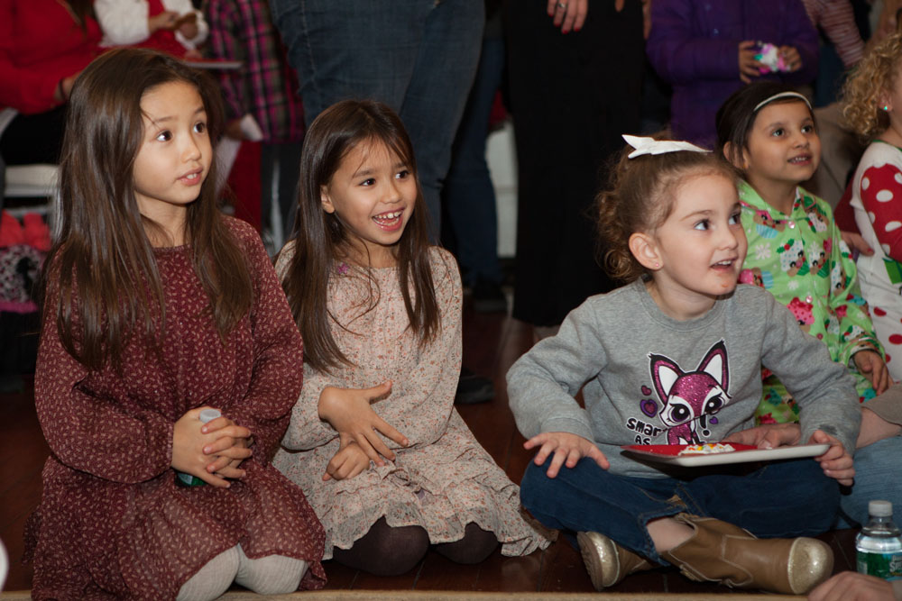 A group of children wait for Santa's arrival at Brecknock Hall in Greenport. (Credit: Katharine Schroeder photos)