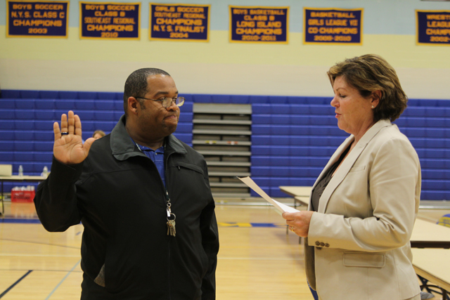 Brian Mealy is sworn in to a one-year term on the Mattituck-Cutchogue Board of Education Tuesday evening. (Credit: Jen Nuzzo)