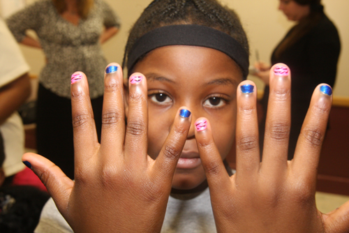 Zonura Williams, 9, picked a pink and blue colors with a zebra print design for her manicure.