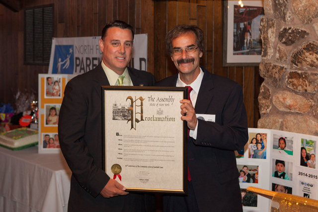 Assemblyman Anthony Palumbo presents Denis Noncarrow with a proclamation honoring the 50th anniversary of CAST.