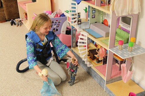 Camryn plays with her dollhouse during her each morning before heading to school.