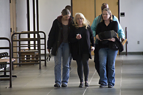 Christine Stulsky, center, walks out of court after being released on bond last month. (Credit: Paul Squire)