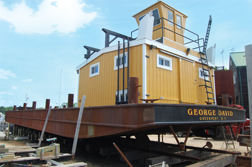 John Costello, owner of Costello Marine Contracting, began working on this barge with his brother, George David Costello, before his brother died suddenly in December 2012. He's since named the barge after George. (Credit: Vera Chinese)