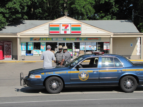 CYNDI MURRAY FILE PHOTO | Law enforcement officials outside Cutchogue 7-Eleven.