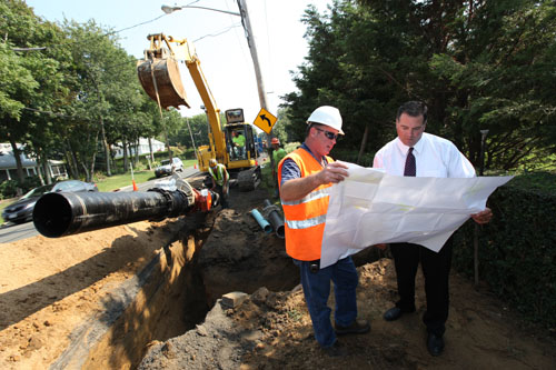 PHOTO COURTESY SCWA | SCWA employees Carl Pfeifer and Tim Motz at the site of the Cutchogue water main extension.
