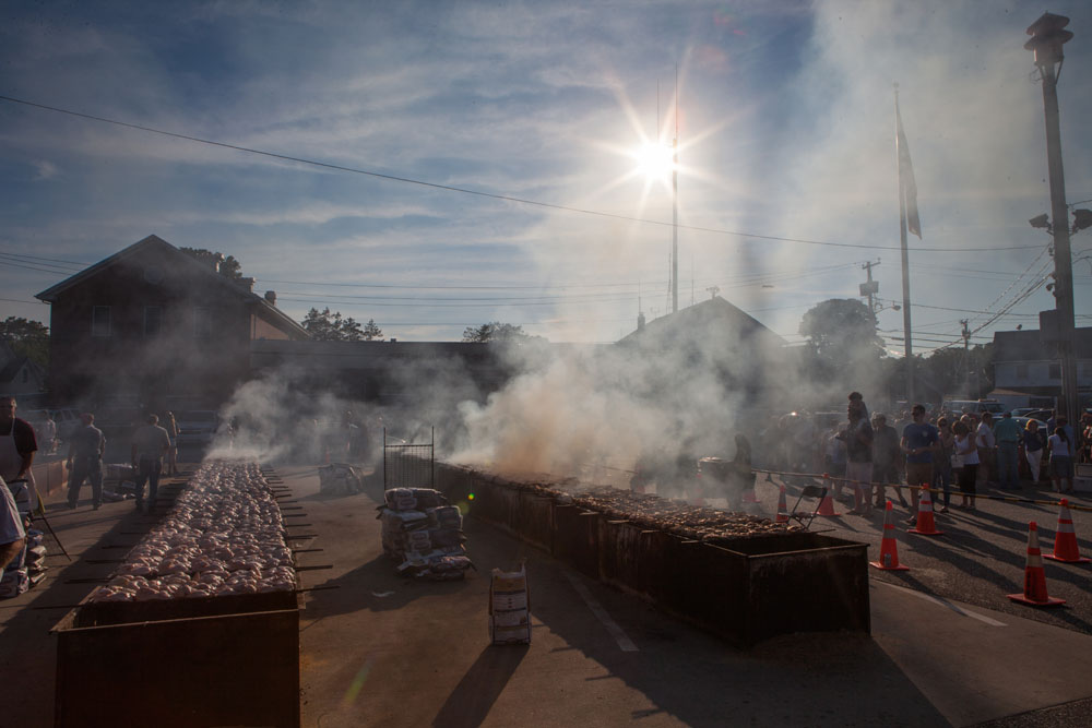 Smoke billows from the grilling area. (Credit: Katharine Schroeder)