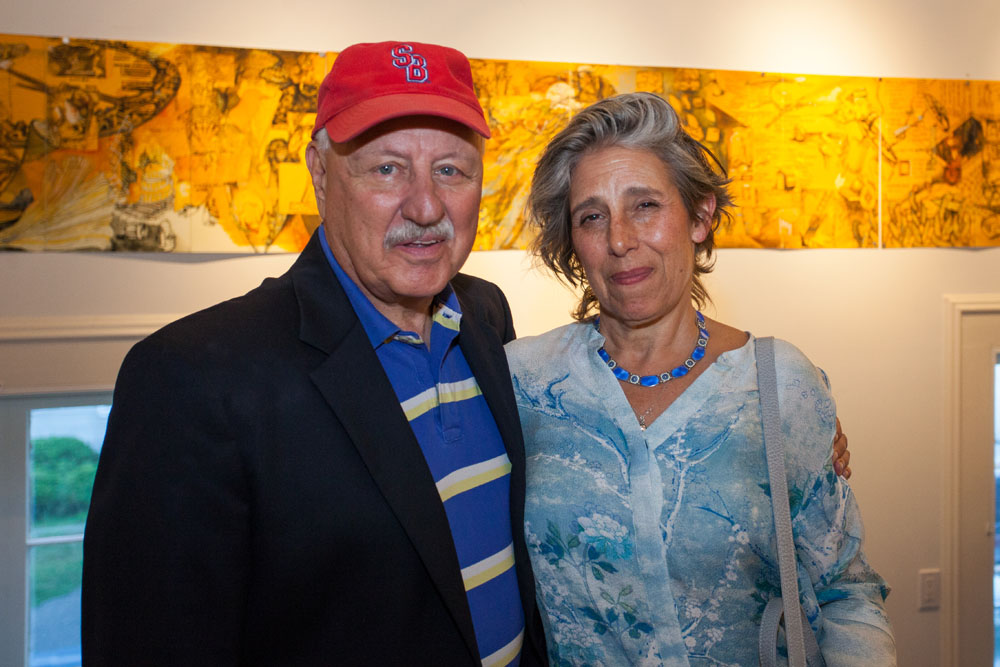 Senator Ken LaValle with artist Ellen Wiener. Her artwork can be seen in the background. (Credit: Katharine Schroeder)