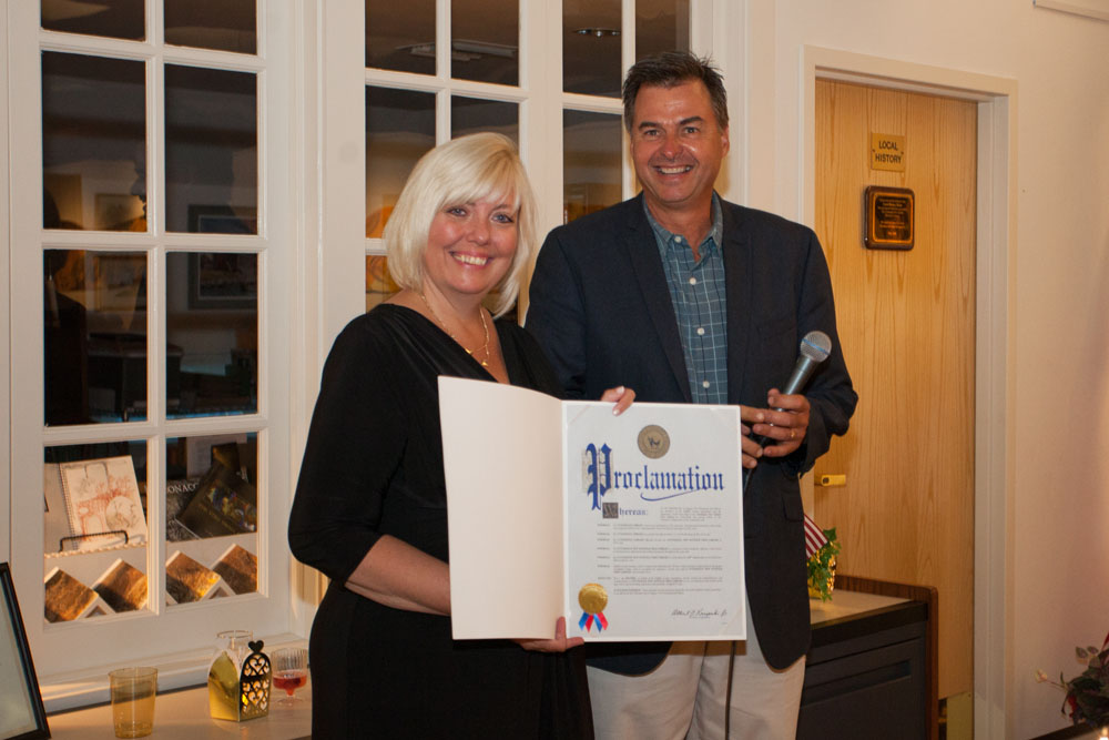 Al Krupski presents Jennifer Fowler with a proclamation. (Credit: Katharine Schroeder)