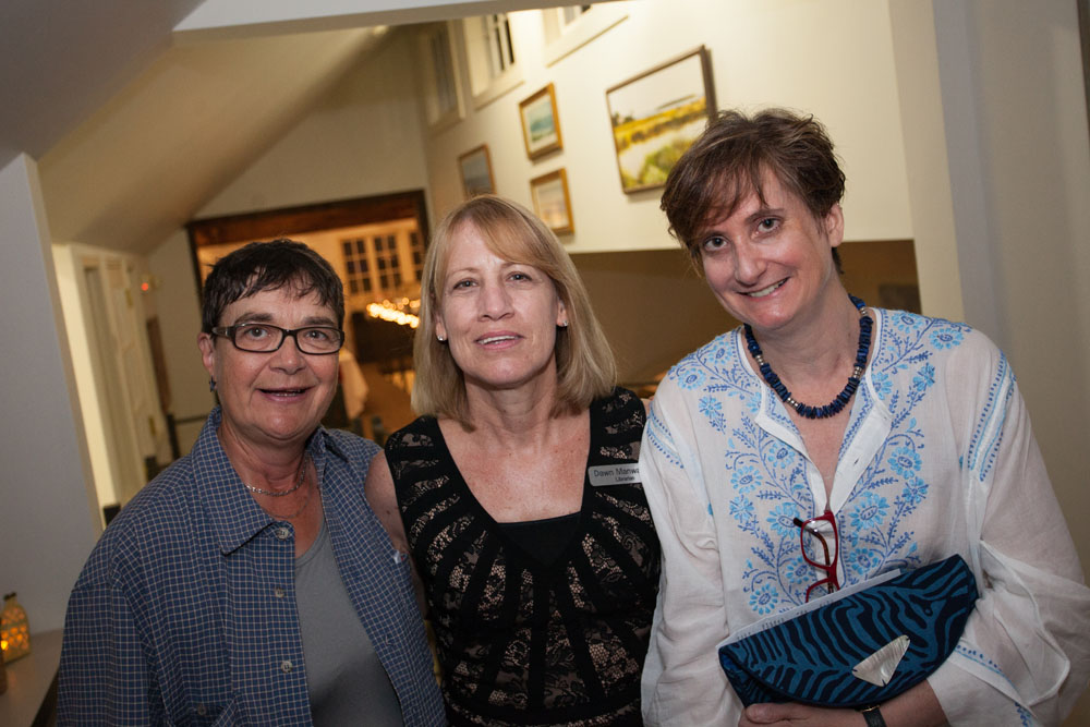From left:  Board member Paula Hepner, librarian Dawn Manwaring, and Alix Ninfo, vice president of the Board of Trustees. (Credit: Katharine Schroeder)