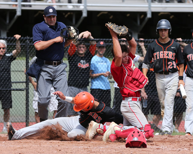 Tuckahoe's Sebastian Santorelli slid below the throw as catcher Sean Moran fields the ball. (Credit: Daniel De Mato)