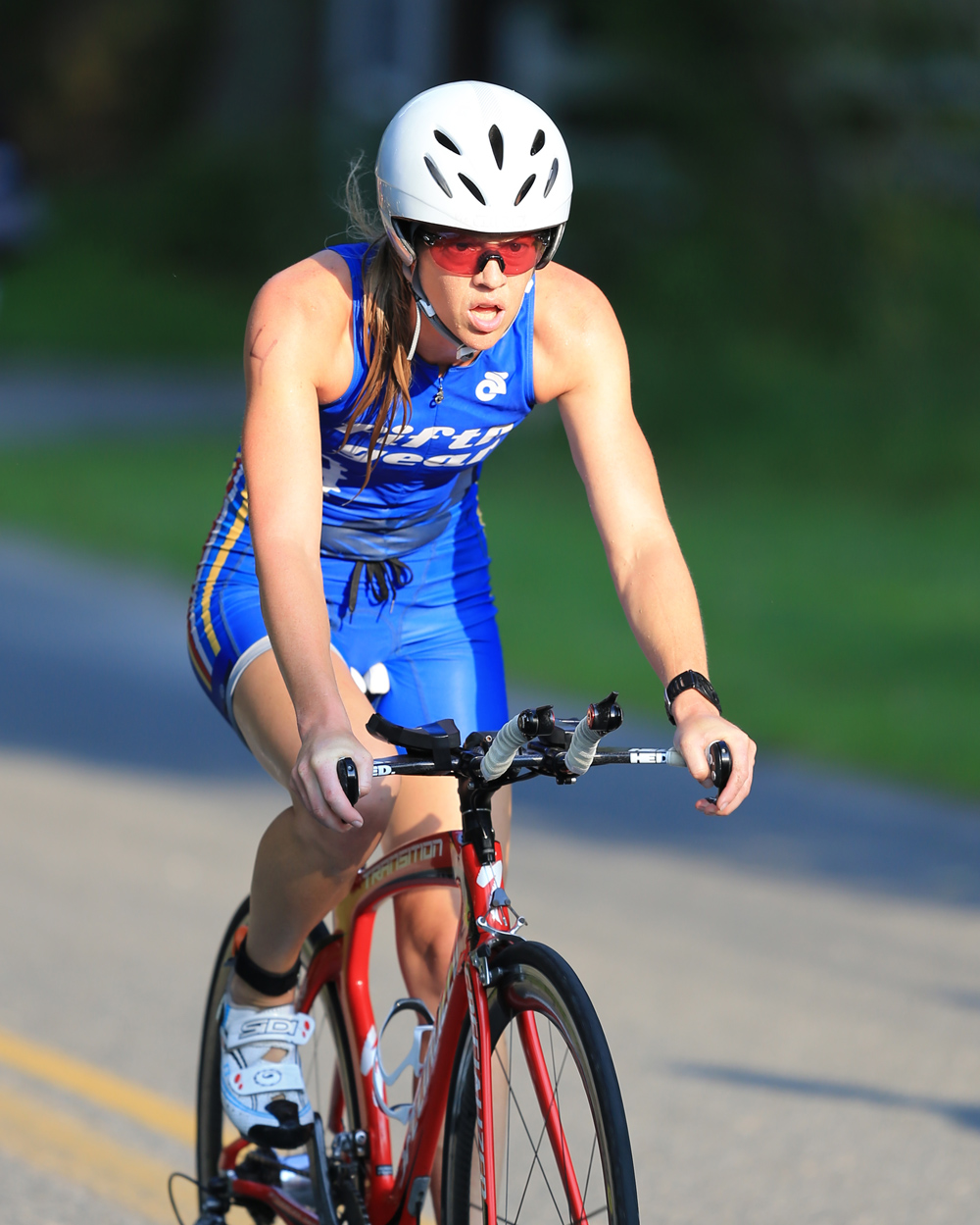 Jennifer Place of Southold leads the women's division during the Bicycle leg of the Mighty North Fork Triathlon Sunday. (Credit: Daniel DeMato)