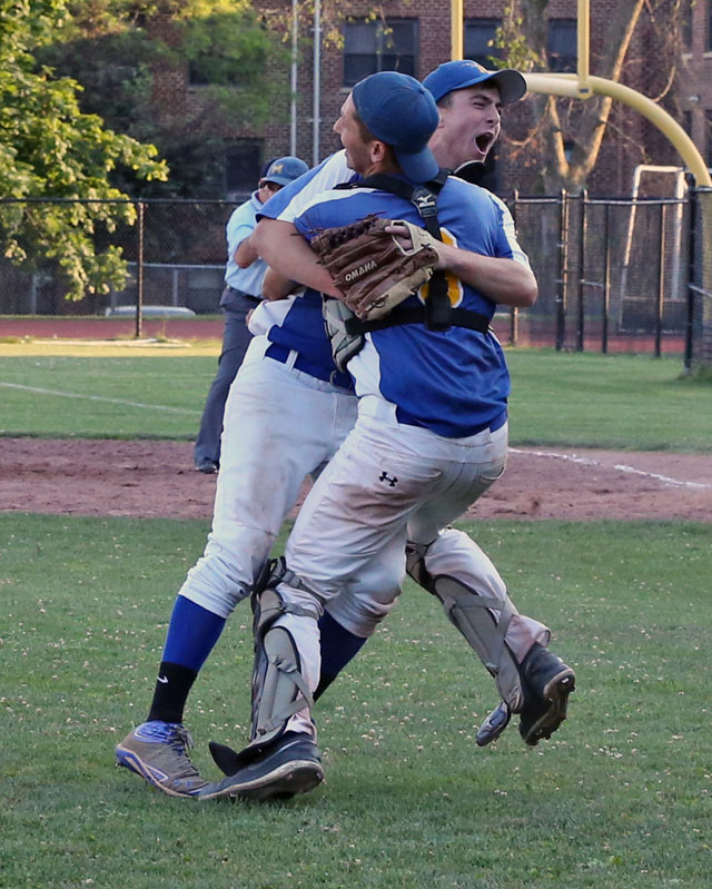 Chris Dwyer and Mike Onufrak celebrate after Mattituck defeated Albertus Magnus 9-5 in extra innings in the Class B Baseball South East Regional Championship game at Mamaroneck High School in Mamaroneck. (Credit: Daniel De Mato)