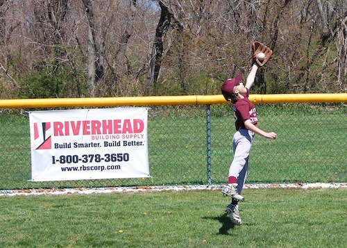 Brenden Buckley, 9, makes a catch.
