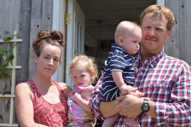 Carey and Regan Meador of Southold Farm + Cellar with their two children, Coralai and Sawyer, outside their Southold tasting barn. (Credit: Vera Chinese)