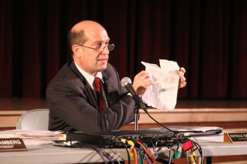 JENNIFER GUSTAVSON PHOTO | Southold School District Superintendent David Gamberg holding an article he's carried around since 2010 that reminds him why the district didn't take Race to the Top funds.