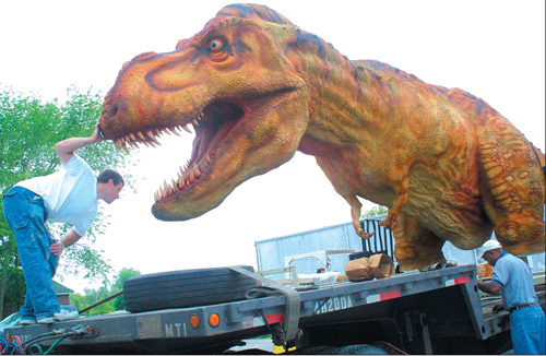 Barbaraellen Koch file photo | Employees of the Dinosaur Walk set up shop in Riverhead in 2004.