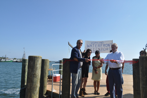 Congressman Tim Bishop cuts the ribbon at Widow's Hole Oysters on Saturday morning. (Credit: Joseph Pinciaro)