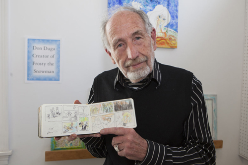 Artist Don Duga with his sketchbook. (Credit: Katharine Schroeder)