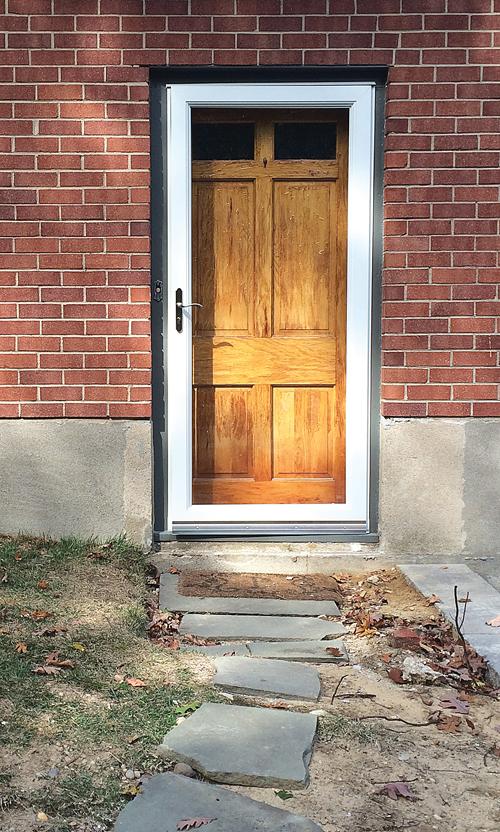 Final step: Hang door. Next on the list: install walkway. (Credit: Joseph Pinciaro)