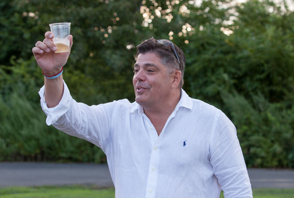 Chris Pia makes a toast.