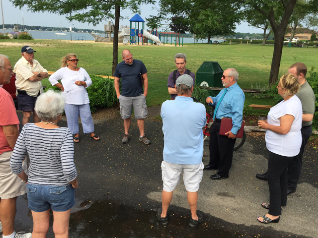 Greenport village administrator Paul Pallas, right, discusses drainage plans for Fifth Street Park with community members Monday. (Credit: Grant Parpan)