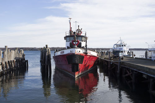 FILE PHOTO | Firefighter still docked in Greenport Harbor despite board's demand for it to relocate.