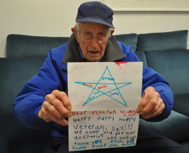 Fred Carter of Cutchogue holds up a handmade card he received from a group of local Girl Scouts.