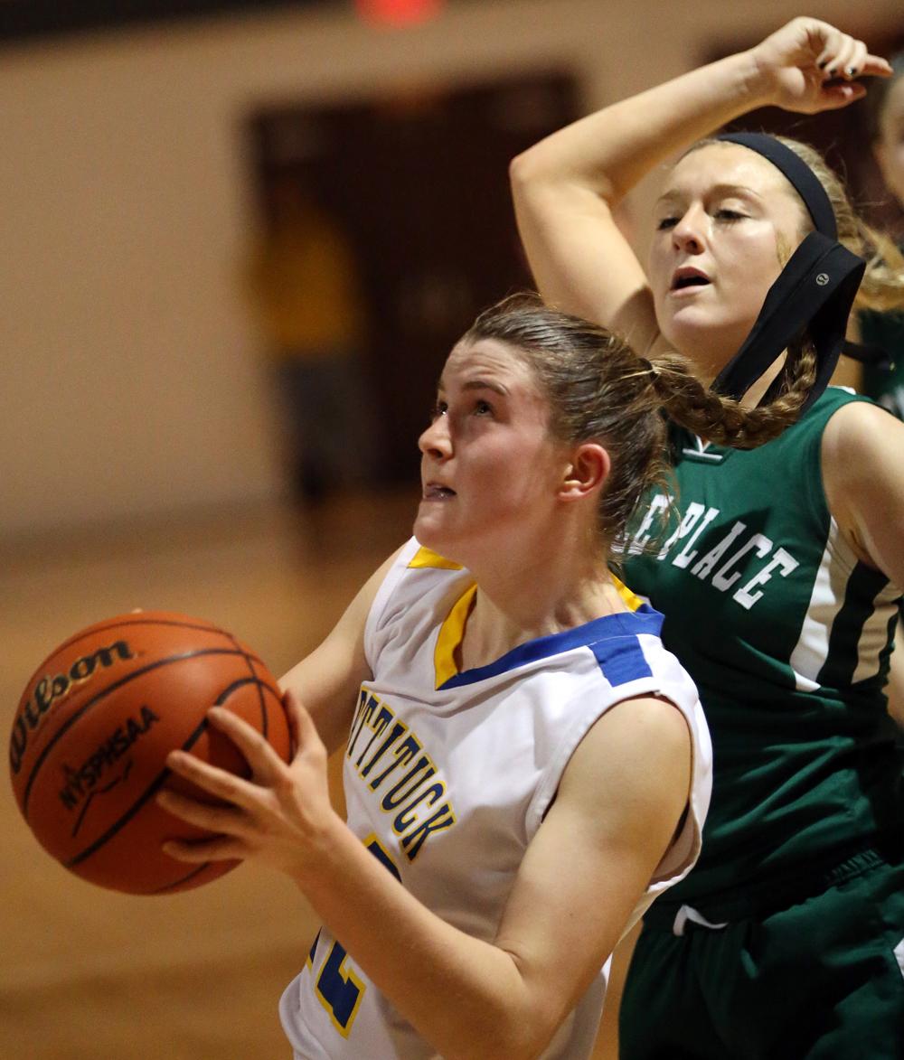 Corinne Reda drives to the basket. (Credit: Garret Meade)