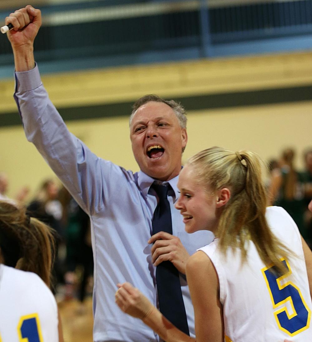 Mattituck coach Steve Van Dood celebrates the team's victory. (Credit: Garret Meade)