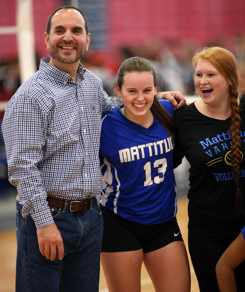 Setter and co-captain Carly Doorhy (13) and coach Frank Massa were all smiles after the win.