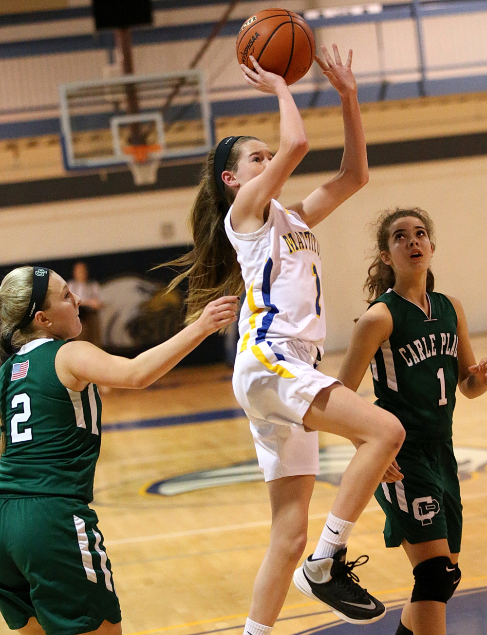 Mackenzie Daly floats a shot in the lane. (Credit: Garret Meade)