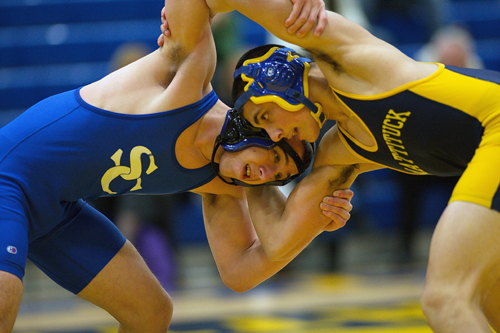 GARRET MEADE PHOTO     Matt Migliore of Smithtown Christian, left, and Christian Angelson of Mattituck/Greenport locked horns at 152 pounds. Migliore won, 6-3.