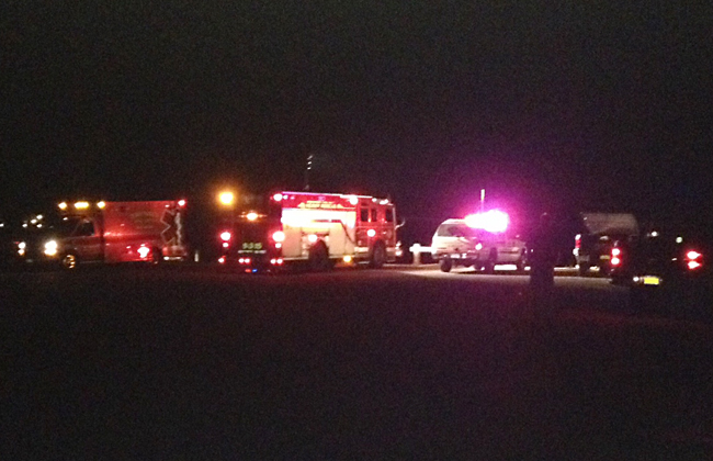 Police and fire departments respond to the scene in Greenport Friday night. (Credit: Andrew Derr)