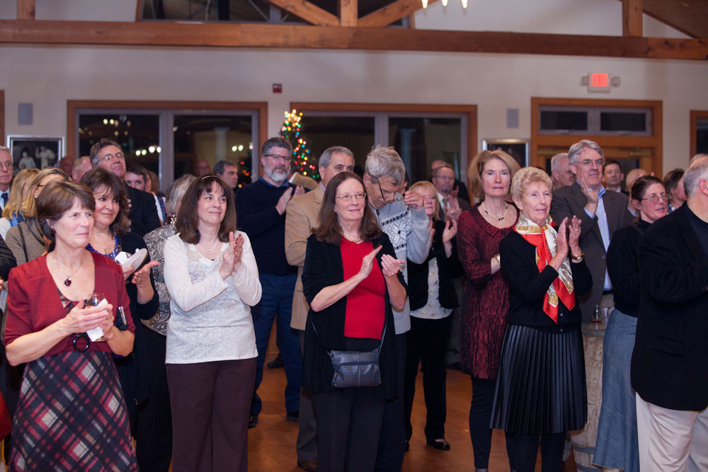 Friends and colleagues applaud Joe. (Credit: Katharine Schroeder)